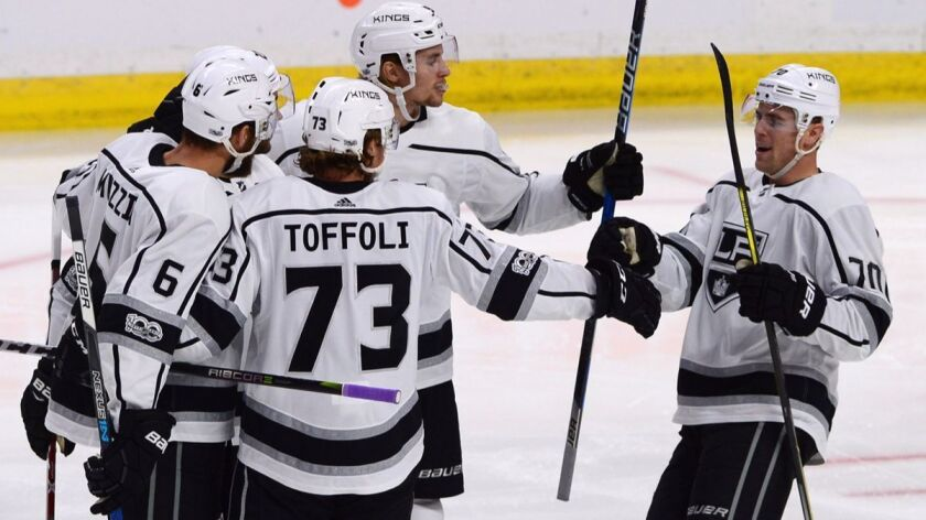 Los Angeles Kings players celebrate a first period goal against the Ottawa Senators during the first