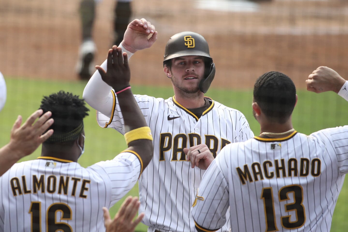 San Diego Padres Wil Myers is congratulated by teammates after hitting a solo home run against the San Francisco Giants' in the second inning of a baseball game Sunday, Sept. 13, 2020, in San Diego. (AP Photo/Derrick Tuskan)