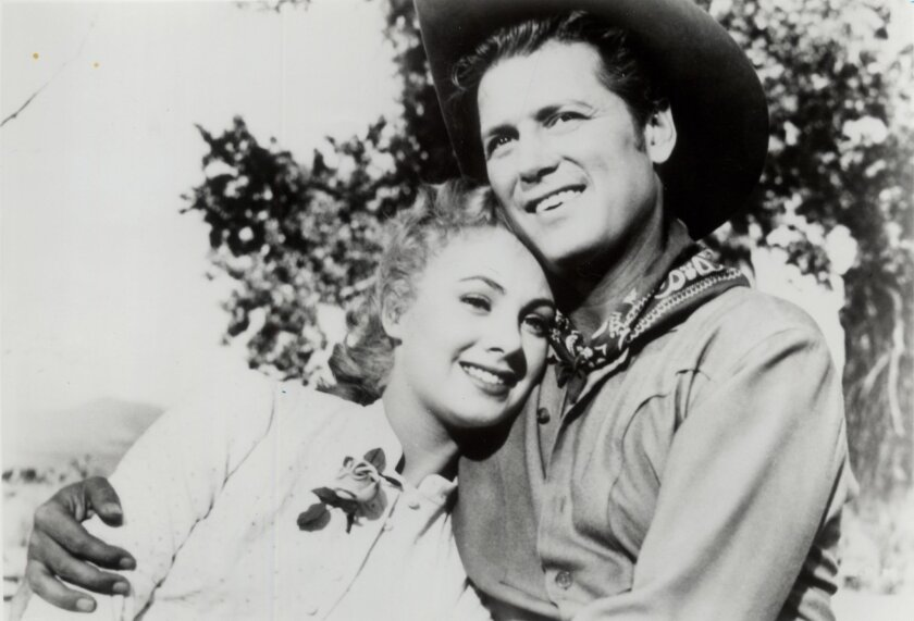 """Shirley Jones and Gordon MacRae in 1955's """"Oklahoma!,"""" one of her early movie roles."""