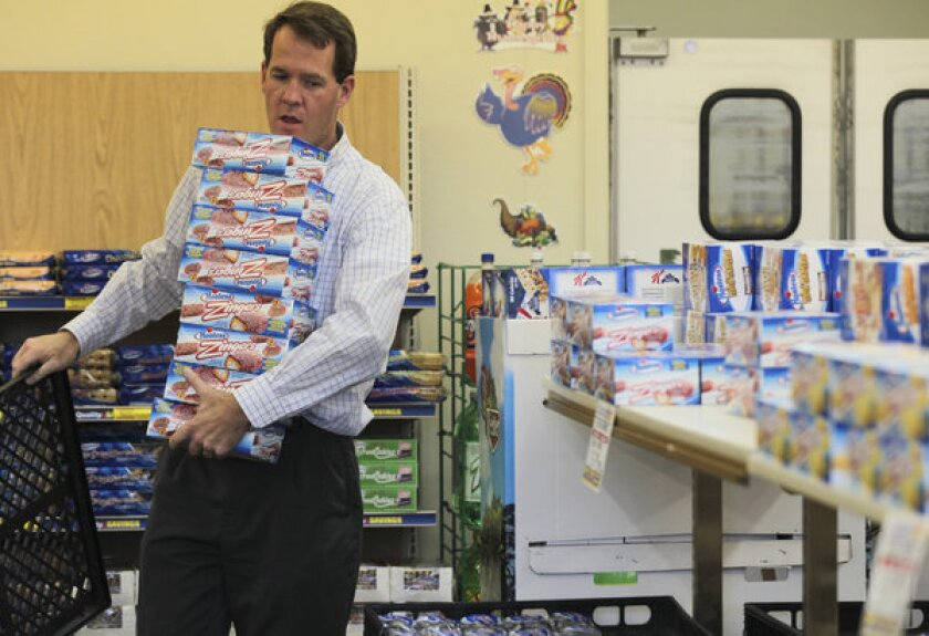 Scott Hubbard loads up on Hostess Zingers at a Hostess store in Redding, Calif. The company is now asking a bankruptcy judge's approval for $1.8 million in executive bonuses.