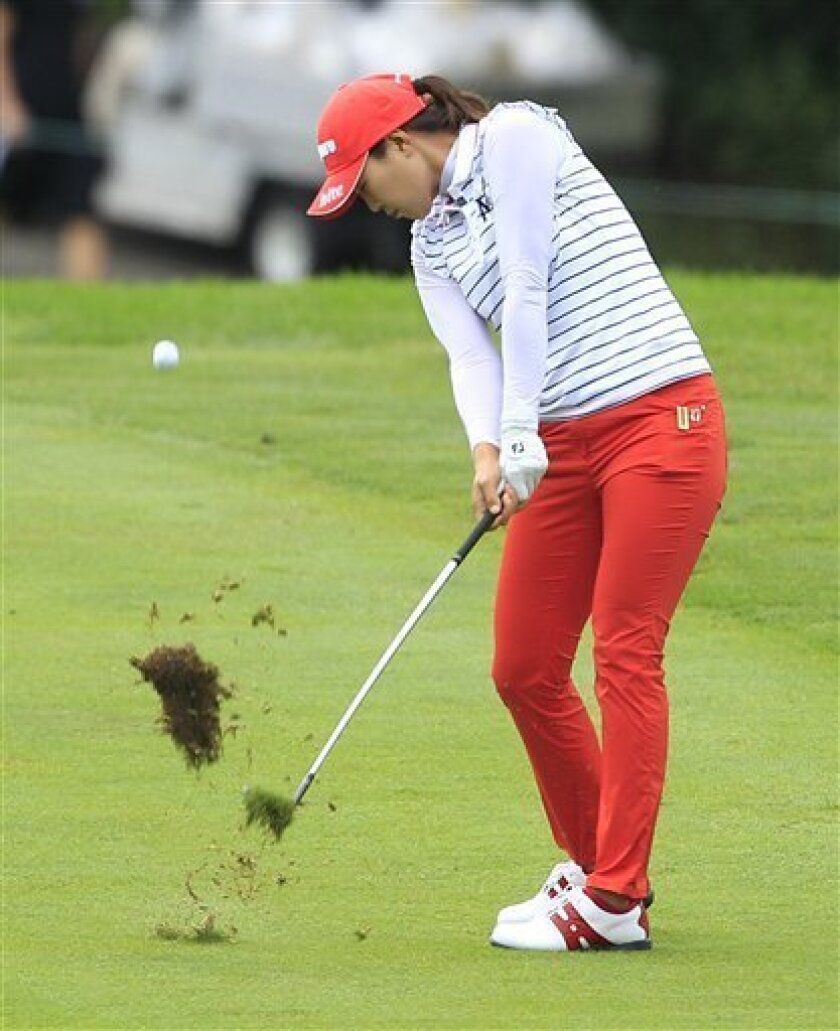 Hee Kyung Seo, of South Korea, hits onto the 18th green during the second round of the Jamie Farr Toledo Classic at the Highland Meadows Golf Club in Sylvania, Ohio, Friday, Aug. 10, 2012. (AP Photo/Carlos Osorio)