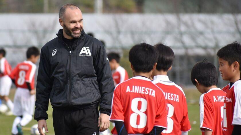 Vissel Kobe's Spanish midfielder Andres Iniesta attends a training session with children in Kobe on Nov. 25, 2018.