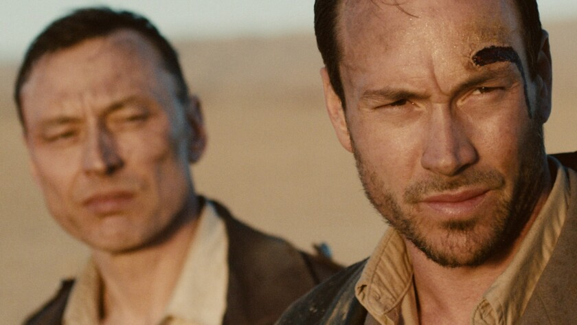 "Werner Daehn, left, and Chris Klein in the movie ""Game of Aces."""