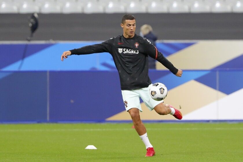 Portugal's Cristiano Ronaldo kicks a ball during warmup before a UEFA Nations League match against France