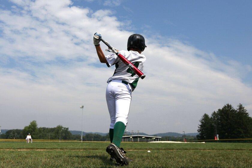 Nick Conlin takes some practice swings yesterday. (John R. McCutchen / Union-Tribune)