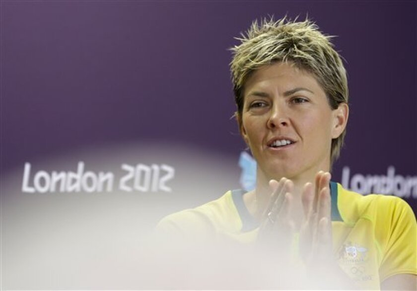 Five-time Olympian Natalie Cook from Australia gestures during a press conference at the 2012 Summer Olympics on, Thursday, Aug. 2, 2012 in London. The beach volleyballer was eliminated on Wednesday. (AP Photo/Ferdinand Ostrop)