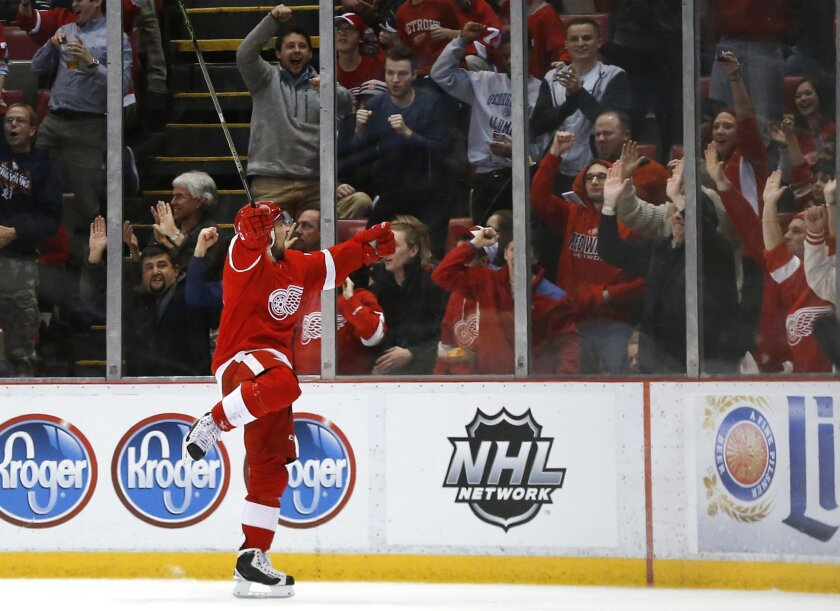 Detroit Red Wings left wing Tomas Tatar (21) celebrates his goal against the Florida Panthers in the third period of an NHL hockey game, Monday, Feb. 8, 2016 in Detroit. (AP Photo/Paul Sancya)