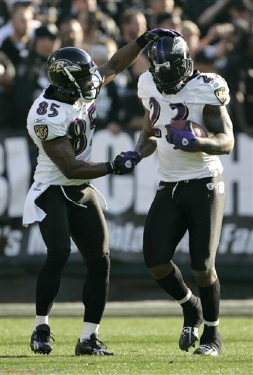Baltimore Ravens running back Willis McGahee (23) celebrates with wide receiver Derrick Mason (85) after scoring on a 77-yard touchdown run against the Oakland Raiders in the second quarter of an NFL football game in Oakland, Calif., Sunday, Jan. 3, 2010. (AP Photo/Marcio Jose Sanchez)