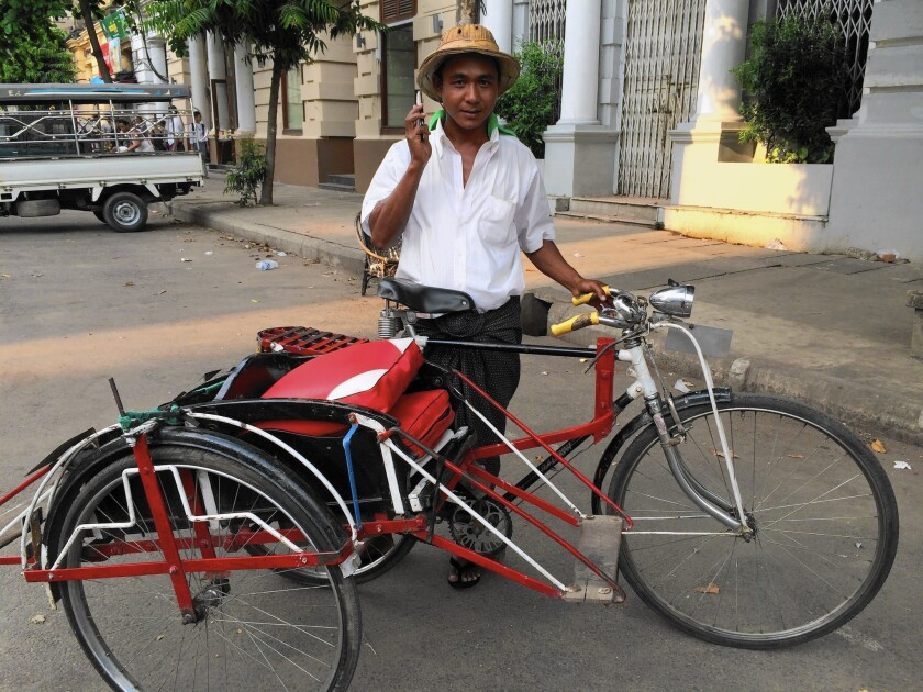 Linn Naing is one of more than 26,000 licensed sidecar drivers in Yangon, Myanmar. With fares ranging from 20 cents to 50 cents, sidecars remain a cheaper option than taxis for short-distance trips.