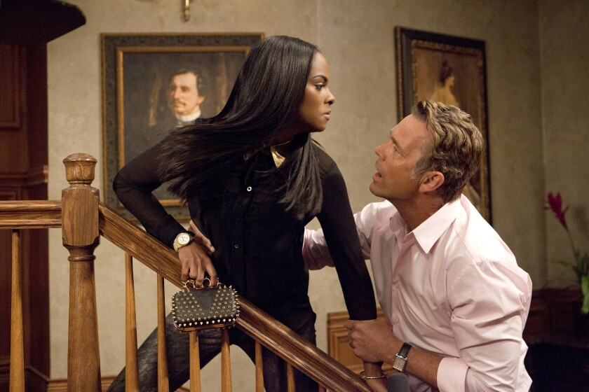 "Candace Young (Tika Sumpter) and Jim Cryer (John Schneider) from ""The Haves and the Have Nots"""