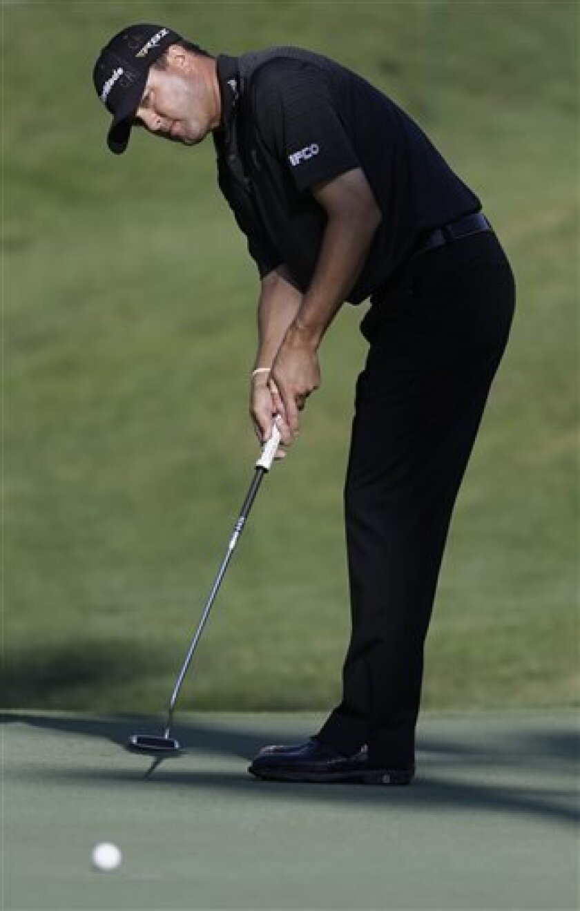 Ryan Palmer watches his putt on the fifth hole during the second round of The Players championship golf tournament at TPC Sawgrass, Friday, May 10, 2013 in Ponte Vedra Beach, Fla. (AP Photo/John Raoux)