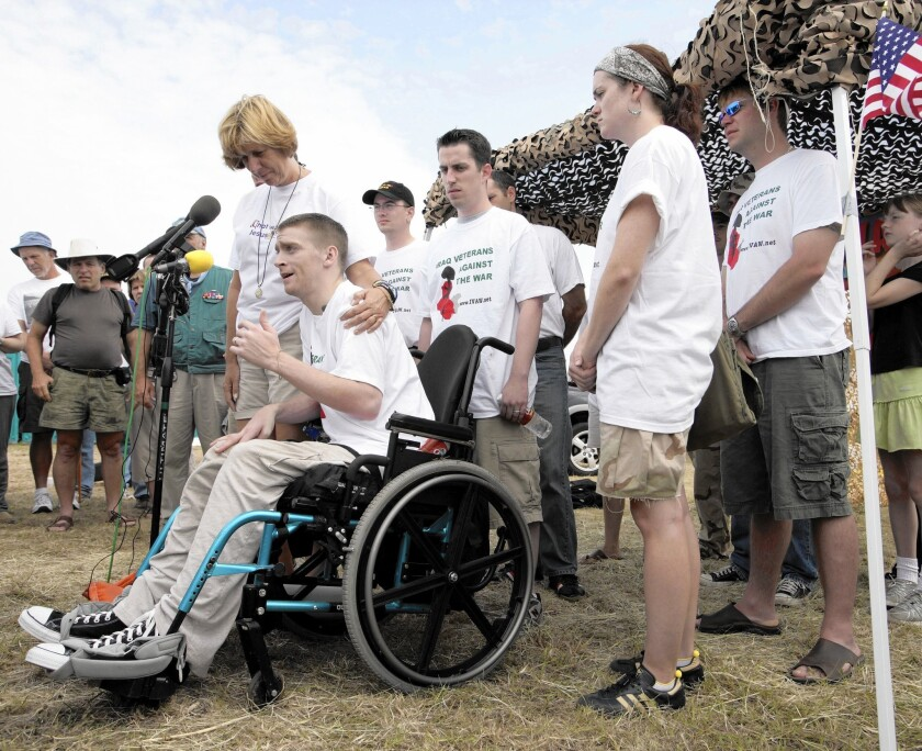 Antiwar activist Tomas Young and others hold a protest in August 2005 in Crawford, Texas, near the ranch of then-President George W. Bush.