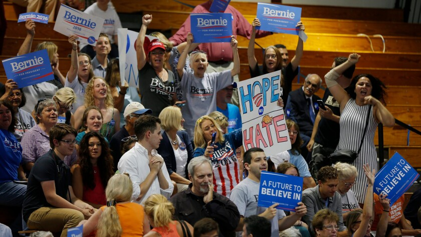 Supporters cheer before Democratic presidential candidate Hillary Clinton appears at an event with Sen. Bernie Sanders at Portsmouth High School in Portsmouth, N.H., on July 11.