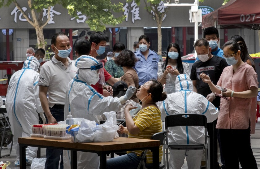 People line up for coronavirus testing in Wuhan, China, where the city government has required that all residents be tested after new cases were reported.