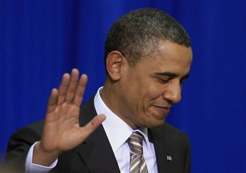 U.S President Barack Obama waves at the Centro Cultural La Moneda Palace before his speech to Latin America in Santiago, Chile, Monday March 21, 2011. Obama is in Chile as part of a three-country, five-day tour of Latin America. (AP Photo/Roberto Candia)