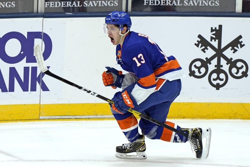 New York Islanders center Mathew Barzal (13) reacts after scoring a goal against Pittsburgh Penguins goalie Caey DeSmith during the third period of an NHL hockey game, Thursday, Feb. 11, 2021, in Uniondale, N.Y. (AP Photo/Kathy Willens)