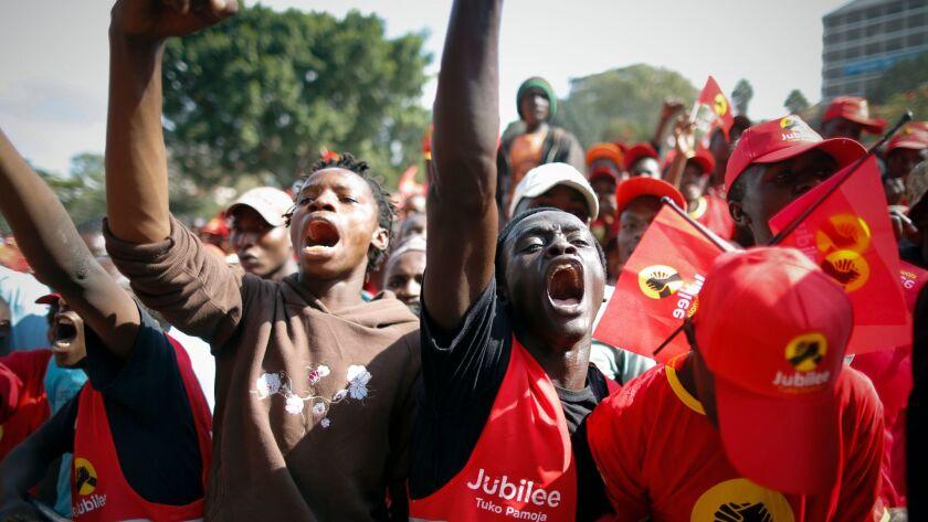 Supporters of incumbent Kenyan President Uhuru Kenyatta cheer at a recent campaign rally in Nairobi.
