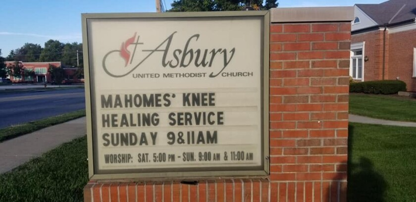 "A sign for the Asbury United Methodist Church with a message advertising ""Mahomes' knee healing service."""
