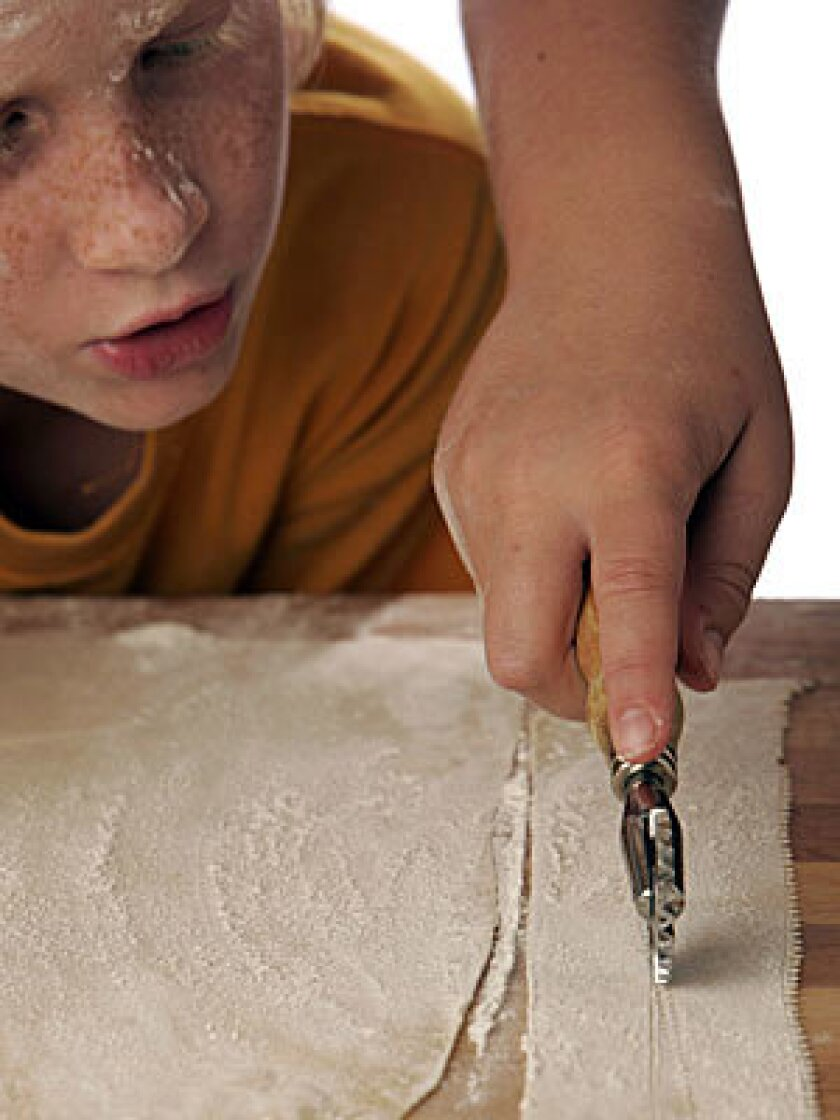 USING THEIR NOODLES: Kneading, rolling, cutting dough. It's a job made for kids.