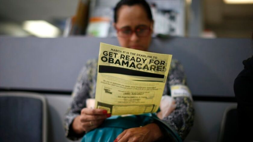 Arminda Murillo, 54, reads a leaflet on Obamacare at a health insurance enrollment event in Cudahy, Calif., March 27, 2014.