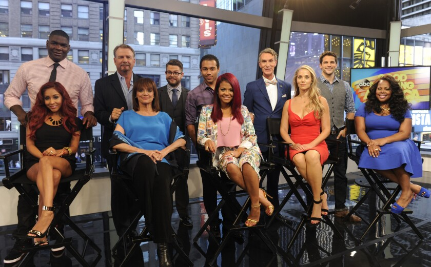 """The upcoming """"Dancing with the Stars cast on """"Good Morning America"""": From left, NFL wide receiver Keyshawn Johnson, comic Bill Engvall, TV personality Jack Osbourne, actor Corbin Bleu, Bill Nye the """"Science Guy,"""" actor Brant Daugherty, and seated from left, TV personality Nicole """"Snooki"""" Polizzi, actress Valerie Harper, singer-actress Christina Milian, actress Elizabeth Berkley Lauren and actress Amber Riley. Actress Leah Remini will also be a contestant."""