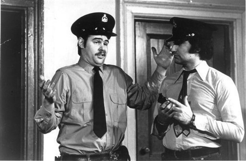In this 1974 photo from The Second City archives is Dan Aykroyd, left, and Eugene Levy at The Second City in Toronto. Aykroyd was an early member of the troupe's Chicago and Toronto casts that became a comedy college for future SNL casts. (AP Photo/Courtesy The Second City)