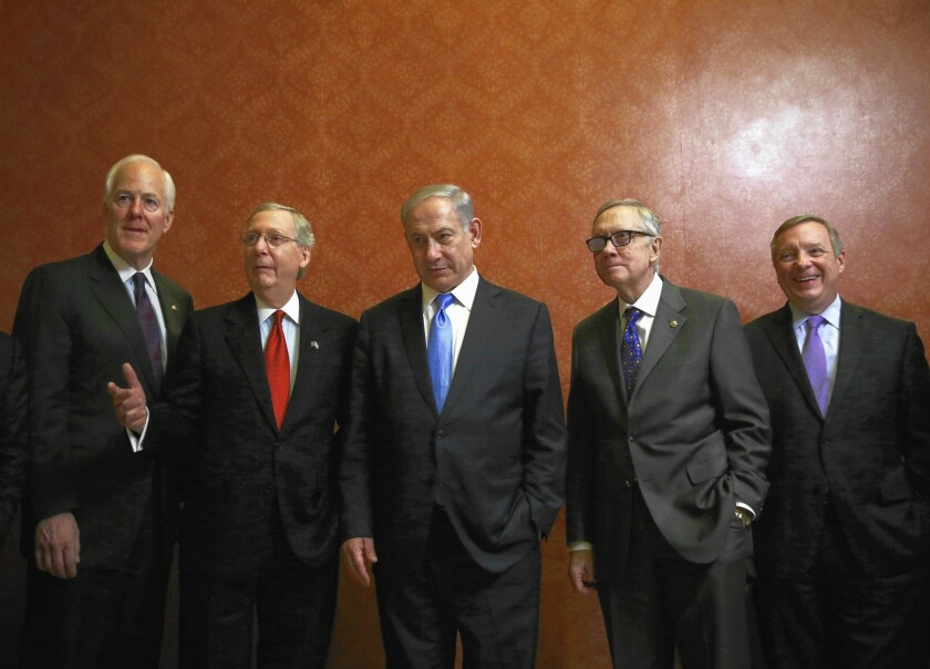 Israeli Prime Minister Benjamin Netanyahu is flanked by, from left, Senate Majority Whip John Cornyn (R-Texas), Majority Leader Mitch McConnell (R-Ky.), Minority Leader Harry Reid (D-Nev.) and Minority Whip Richard J. Durbin (D-Ill.) at the Capitol.