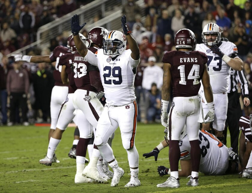 Auburn running back Jovon Robinson (29) raises his arms after rushing for a touchdown against Texas A&M during the second quarter of an NCAA college football game, Saturday, Nov. 7, 2015, in College Station, Texas. (AP Photo/David J. Phillip)
