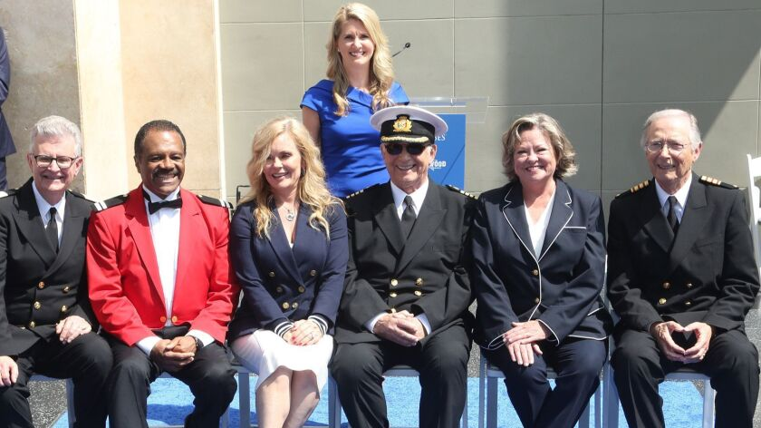 "Jan Swartz, Princess Cruises president, behind the ""Love Boat"" cast: From left, Fred Grandy, Ted Lange, Jill Whelan, Gavin MacLeod, Lauren Tewes and Bernie Kopell. The series received an honorary plaque on the Hollywood Walk of Fame."