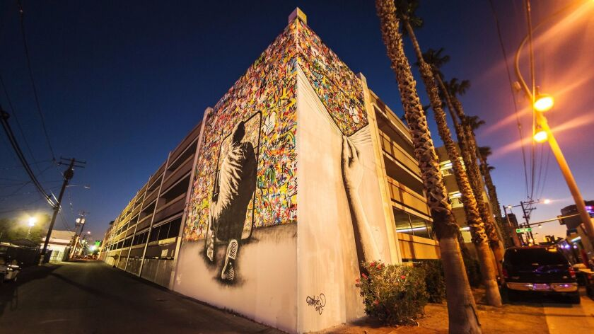 Norwegian artist Martin Whatson's untitled mural covers two walls of a building on Stewart Street between 7th and 8th streets in Las Vegas. His mission is to bring beauty to forgotten spaces.