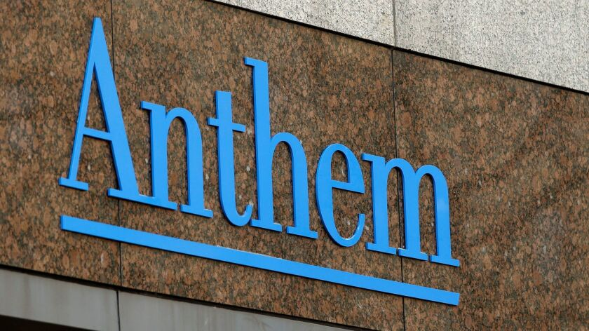 The Anthem logo at the company's corporate headquarters in Indianapolis. Anthem cut two planned premium increases after California regulators challenged its estimates of drug expenses.