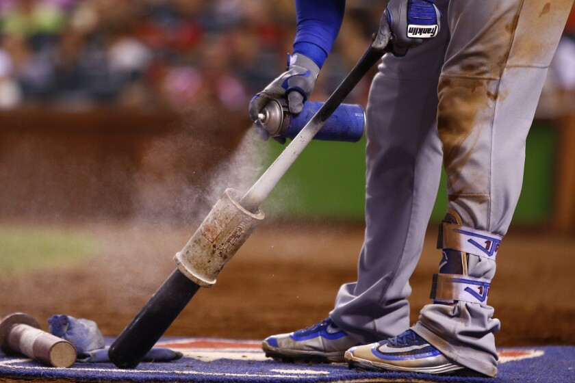 Justin Turner practices the same ritual before each at-bat.
