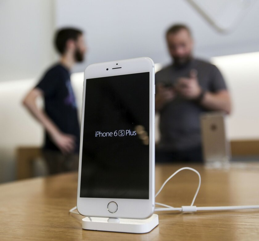 FILE - In this Friday, Sept. 25, 2015, file photo, an Apple iPhone 6s Plus smartphone is displayed at the Apple store at The Grove in Los Angeles. The FBI said Monday, March 28, 2016, it successfully used a mysterious technique without Apple Inc.'s help to hack into the iPhone used by a gunman in a mass shooting in California, effectively ending a pitched court battle between the Obama administration and one of the world's leading technology companies. (AP Photo/Ringo H.W. Chiu, File)