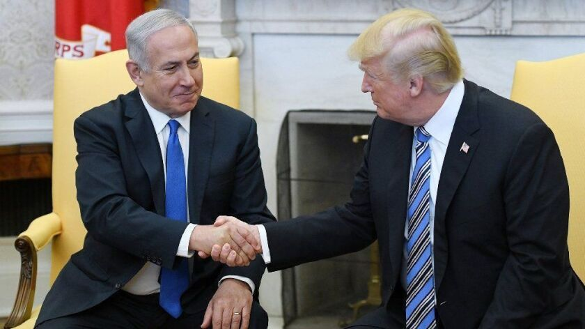 President Trump shakes hands with Israeli Prime Minister Benjamin Netanyahu in the Oval Office on March 5, 2018.