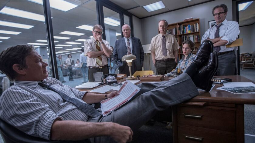 """From left: Tom Hanks, David Cross, John Rue, Bob Odenkirk, Jessie Mueller, and Philip Casnoff in a scene from """"The Post."""""""