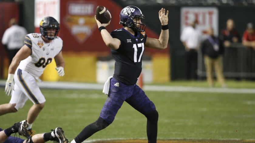 TCU quarterback Grayson Muehlstein (17) throws a pass as California linebacker Evan Weaver, left, watches during the first half.