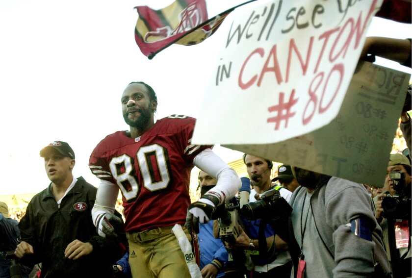 Jerry Rice takes a farewell lap around the field after his final home game with the 49ers on Dec. 17, 2000.
