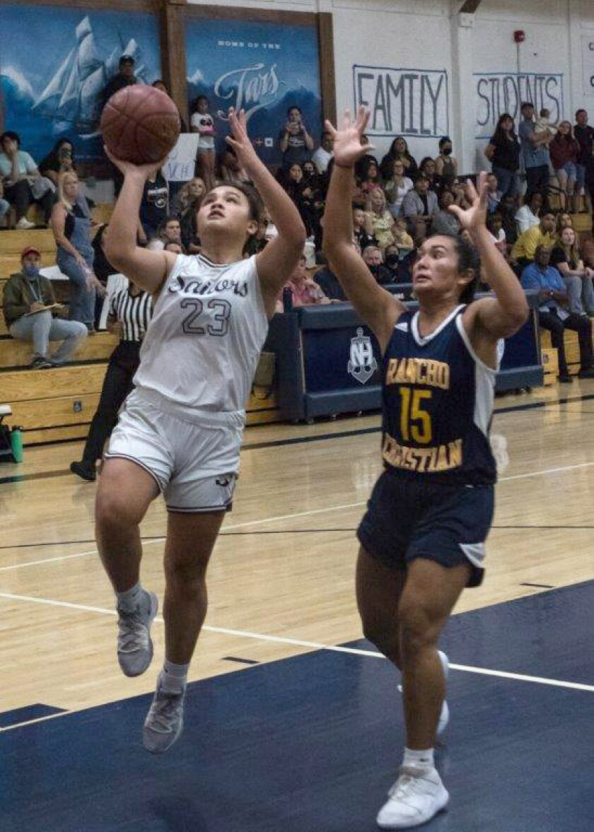 Newport Harbor's Cydney Jover (23) goes up for a layup against Rancho Christian