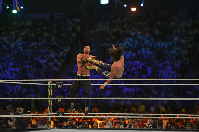 Mansoor delivers a flying kick to Cesaro during a WWE performance from Riyadh, Saudi Arabia, on Oct. 31, 2019.