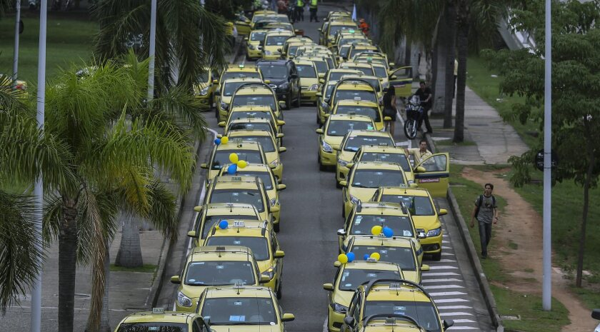 Taxi drivers protest against ride-sharing company Uber in Rio de Janeiro in November.