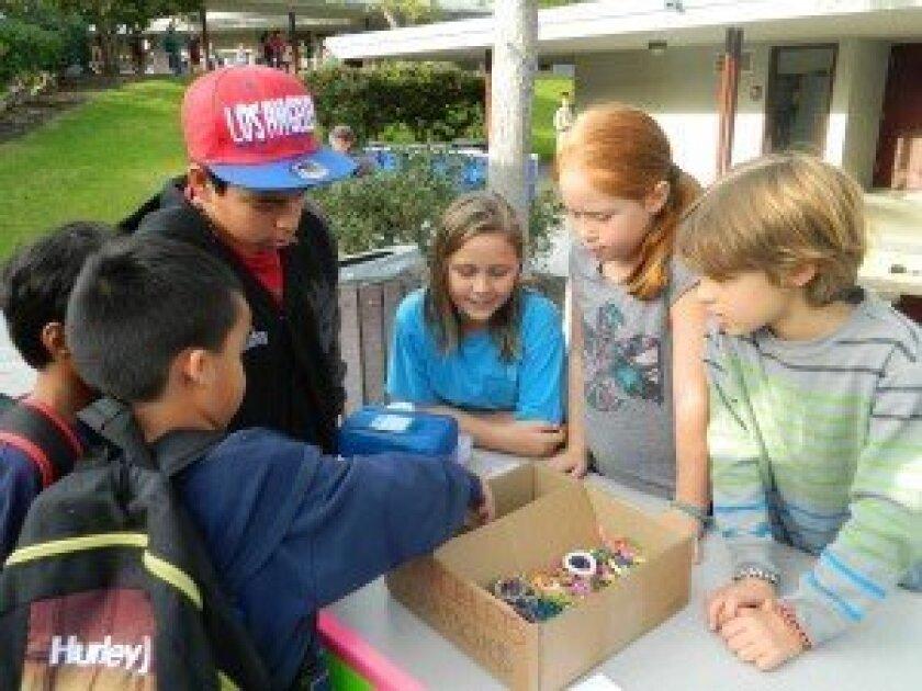 Skyline Elementary School students sold Rainbow Loom bracelets to support Typhoon Haiyan relief efforts. Photos/Kristina Houck