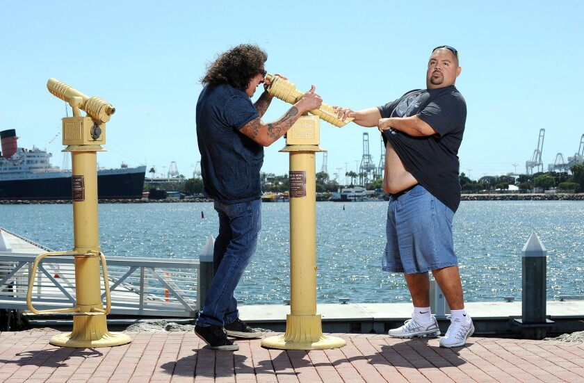 Comedians Gabriel Iglesias, right, and Martin Moreno have fun outside of Parkers' Lighthouse in Long Beach.