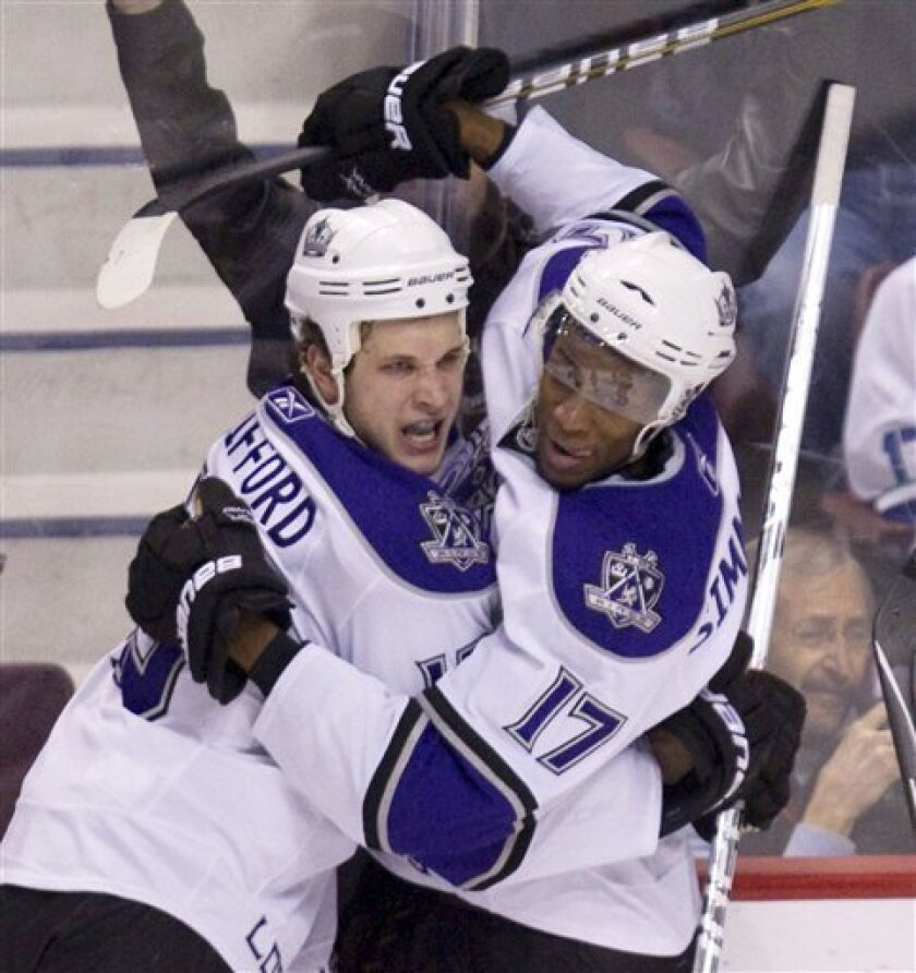 Los Angeles Kings left wing Kyle Clifford (13) celebrates his first period goal against the Vancouver Canucks with teammate Wayne Simmonds at Rogers arena in Vancouver, British Columbia, Thursday, March 31, 2011.  (AP Photo/The Canadian Press, Jonathan Hayward)
