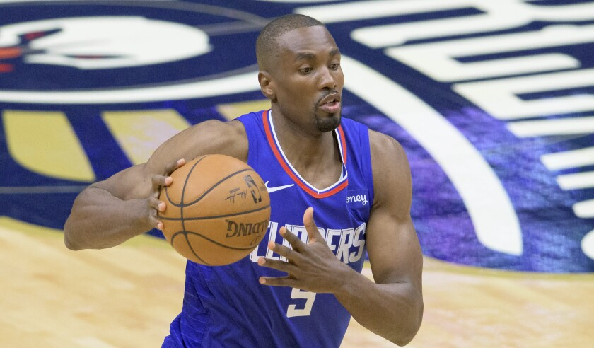 Clippers center Serge Ibaka controls the ball during a game against the New Orleans Pelicans on March 14.
