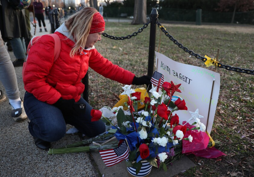 Melody Black from Minnesota visits a memorial set up near the U.S. Capitol building in Washington, D.C., for Ashli Babbitt.