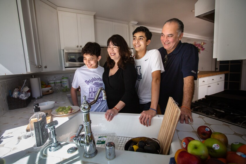 Benjamin and Sebastian Hernandez at home with mother Margaret and father Alex.