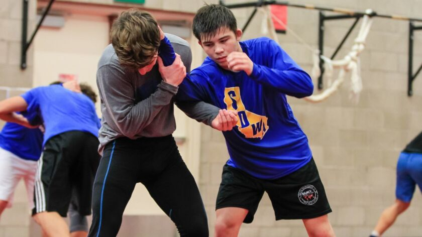 Rancho Bernardo High School wrestler Jaden Abas (right) works out with teammate last December. Abas is ranked No. 1 in the state and No. 2 nationally at his former weight of 138 pounds.