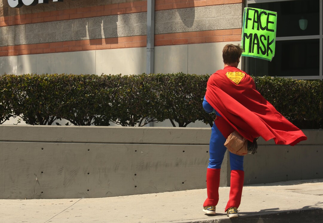 A man dressed as Superman advertises face masks in Marina del Rey.
