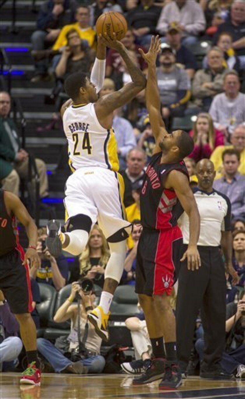 Indiana Pacers small forward Paul George (24) shoots as Toronto Raptors shooting guard Alan Anderson (6) attempts the block during the first half of an NBA basketball game in Indianapolis, Friday, Feb. 8, 2013. (AP Photo/Doug McSchooler)