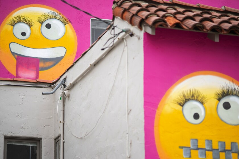 Some neighbors think the painted emojis on the Manhattan Beach house are meant to mock them.